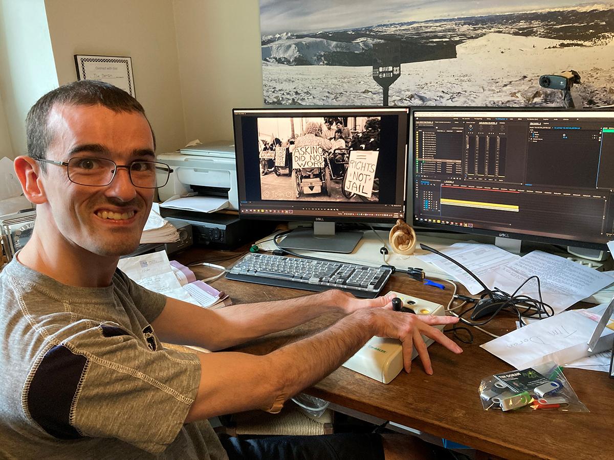 Tim sitting at computer editing video